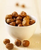 Hazelnut kernels in small white bowl