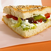 Pita bread filled with vegetables and soft cheese