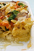Pasta bake with ham, carrots, broccoli and cheese