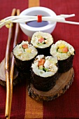 Raw vegetable sushi with sauerkraut, peppers and sprouts