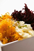 Raw vegetable salad: grated carrots, celery and beetroot