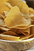 Tortilla chips in wooden bowl