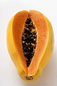 Fresh papaya, a piece cut off