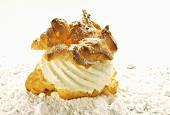 Cream puff with cream and icing sugar