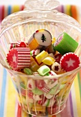 Coloured Christmas sweets in jar