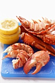 Lobster, cooked and prepared, with slices of lemon