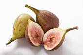 Three fresh figs, one halved