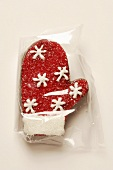 Chocolate praline glove with red granulated sugar