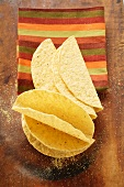 Taco shells in front of striped cloth