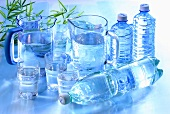 Water in glasses, jugs and plastic bottles