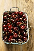 Sweet black cherries in old roasting dish