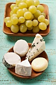 Selection of cheeses and green grapes