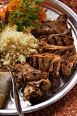Grilled lamb cutlets with couscous and raw carrot salad