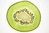 Slice of kiwi fruit, backlit