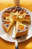 Apricot cheesecake, a piece cut