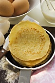 Piling up pancakes in frying pan