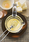 Hollandaise sauce in a small glass pan