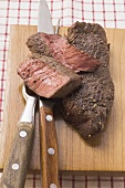 Beef steaks, partly sliced