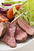 Beef steak, sliced, with salad
