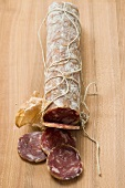 Italian salami with slices cut