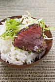 Raw tuna fillet with poppy seeds on rice