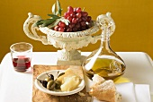 Olives, Parmesan, bread, olive oil, red grapes and red wine