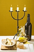 Olive, Parmesan, bread, olive oil, wine bottle, candlestick