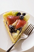 Piece of fruit gateau with fork