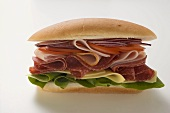 Salami, ham, cheese and salad sandwich