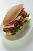 Salami, ham, cheese and salad sandwich on plate