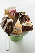 A selection of pieces of cake on cake stand