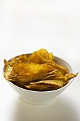 Potato crisps in bowl