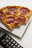 Piece of salami & cheese pizza, bites taken, for the office