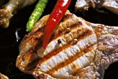 Grilled pork chop with pepper and chili peppers