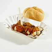 Currywurst (curry sausage) with bread roll