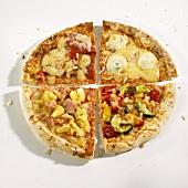 Quarters of four different pizzas