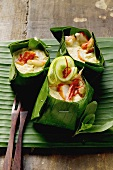 Crabmeat with coconut sauce in banana leaf