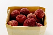 Lychees in woodchip basket