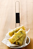 Spring rolls on straining spoon