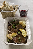 Beef pot roast with potatoes, red wine, white bread