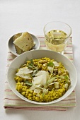 Risotto with sage, pine nuts & Parmesan, glass of white wine