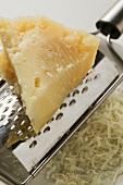 Piece of Pecorino with grater (close-up)