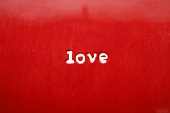 The word Love on red plate (close-up)