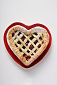 Cherry pie on heart-shaped plate