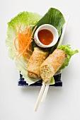 Spring roll, cut in half, on salad (China)
