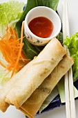Spring rolls on salad with sweet and sour sauce (Thailand)