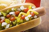 Hot dog with relish, mustard, ketchup, onions and crisps
