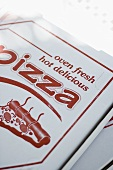 Pizzas in pizza boxes
