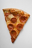 A piece of pepperoni pizza