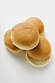 Four hamburger buns, split
